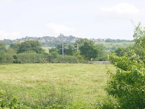 Photo of Mow Cop Castle across fields